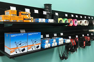 shelf of audio accessories for sale